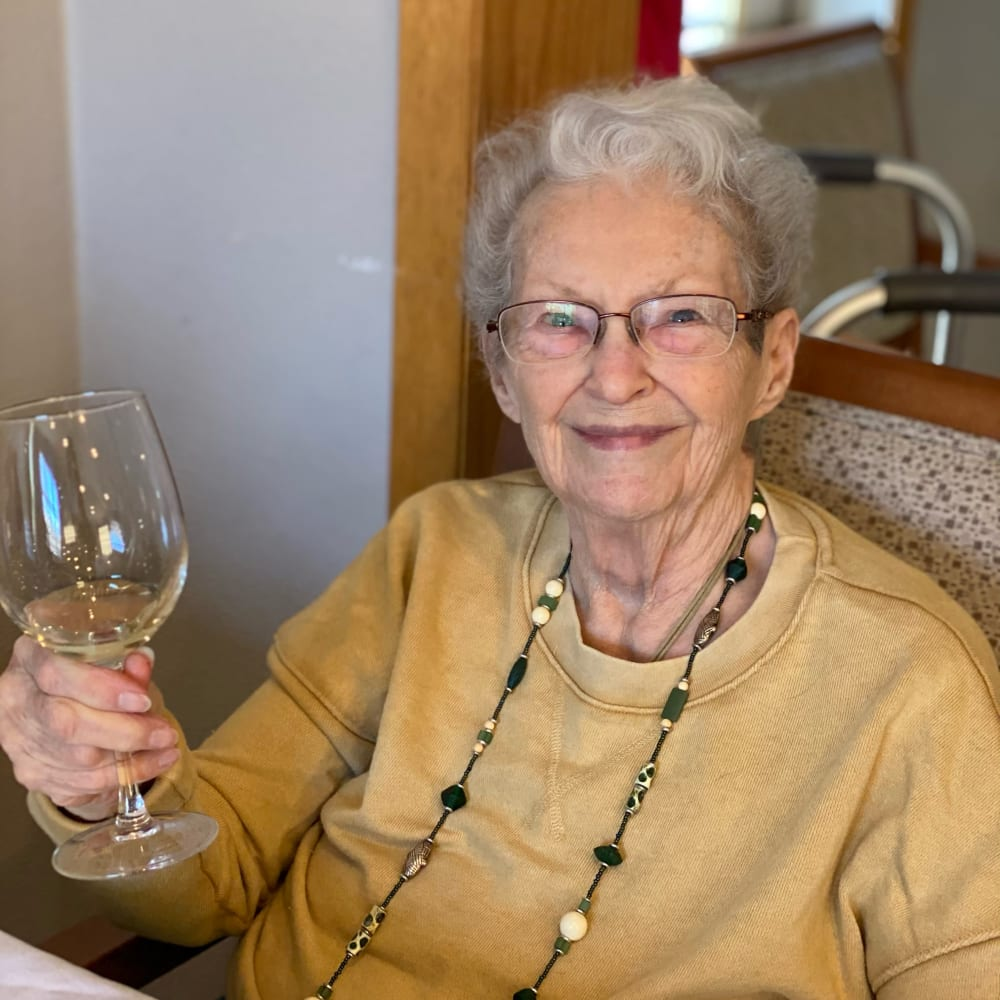 Residents holding a wine glass at Glenwood Place in Marshalltown, Iowa.