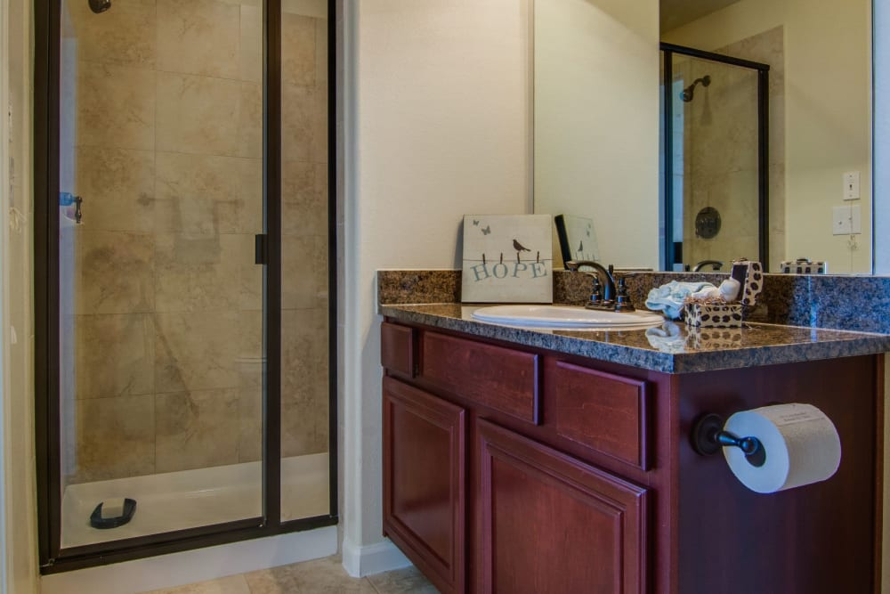 Bathroom with glass shower at Marquis Rockwall in Rockwall, Texas