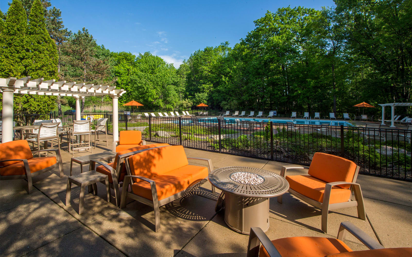 Pool area with chairs and tables at Aldingbrooke in West Bloomfield, Michigan