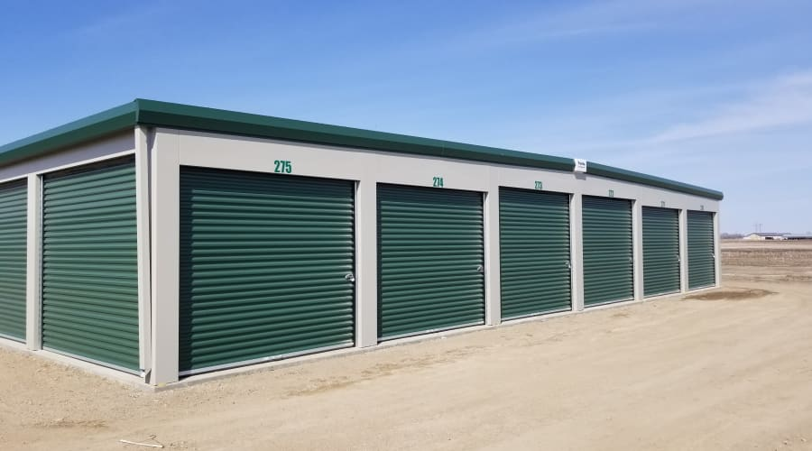 Storage units with green doors and locks at KO Storage of Aberdeen in Aberdeen, South Dakota
