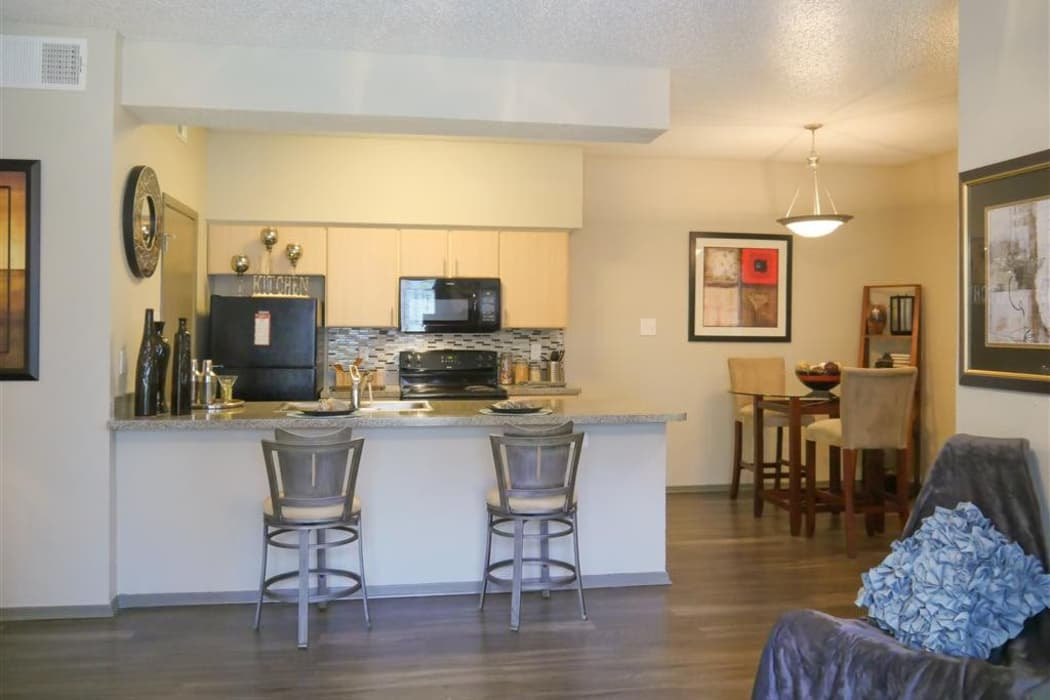 Beautiful kitchen and dining area view of model home at Veridian Place in Dallas, Texas
