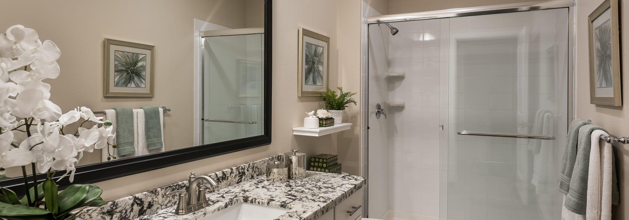 Bathroom with glass door shower at San Artes in Scottsdale, Arizona