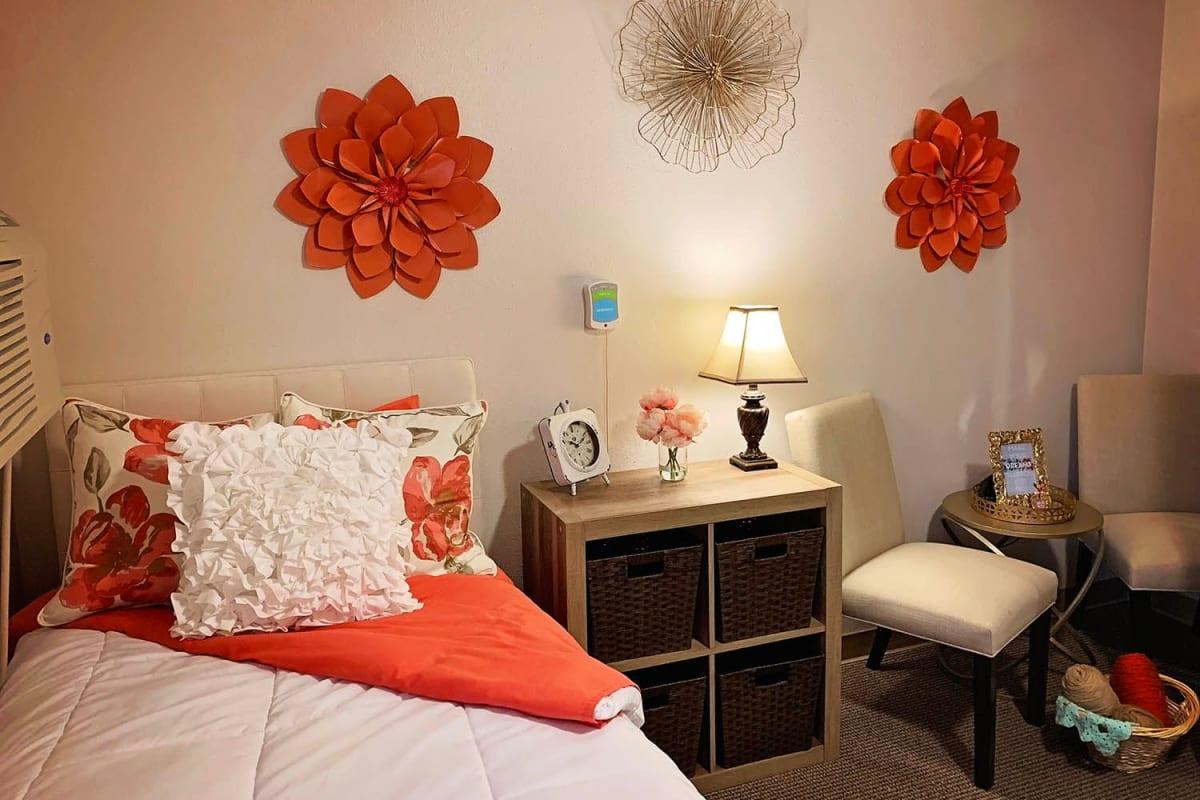 A decorated apartment bedroom at Farmington Square Salem in Salem, Oregon