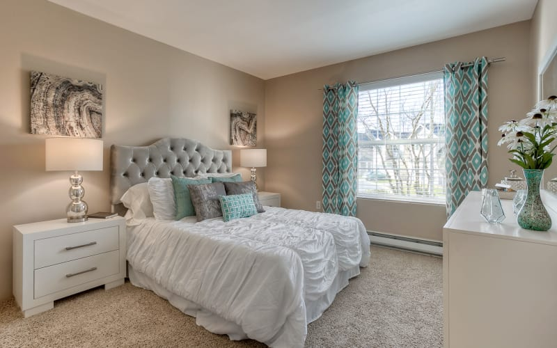 Spacious master bedroom with plush carpeting at Pebble Cove Apartments in Renton, Washington
