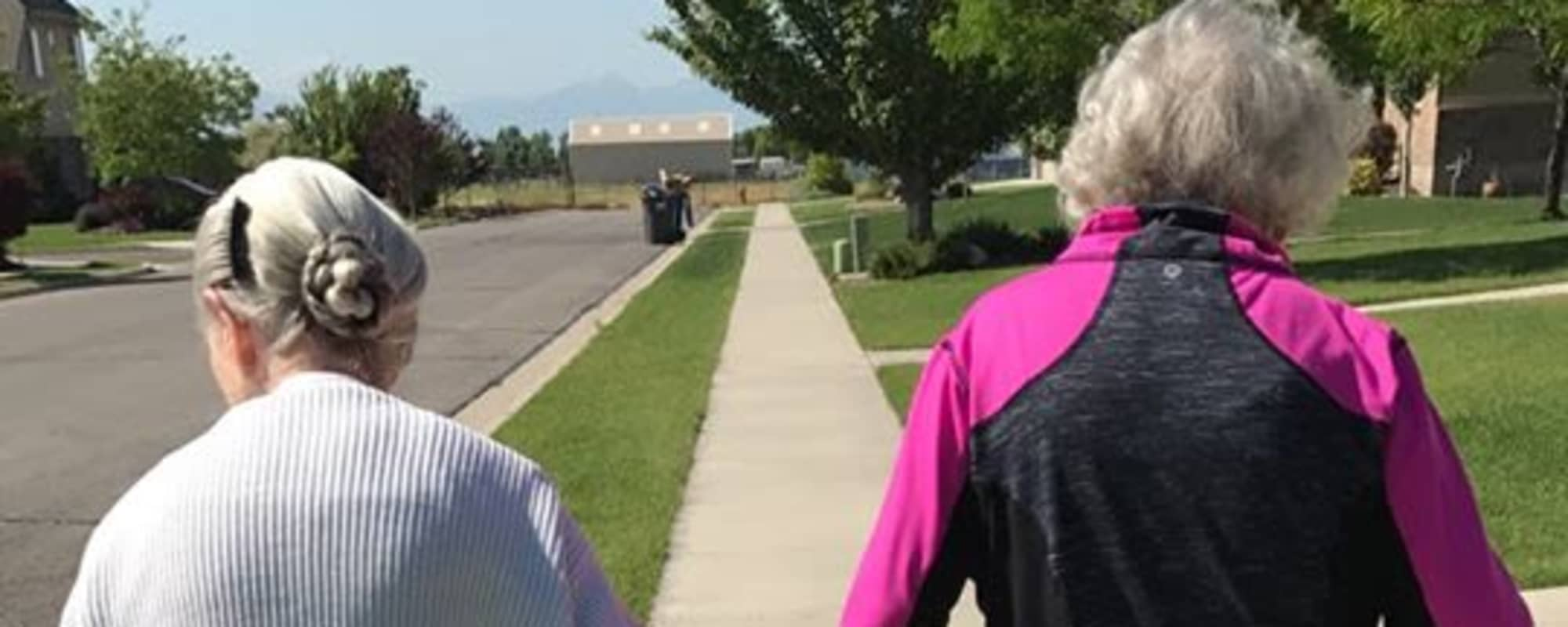 Seniors walking down sidewalk at Highland Glen in Highland, Utah