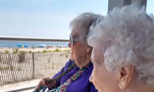 Residents enjoying beach view near Traditions of Cross Keys in Glassboro, New Jersey