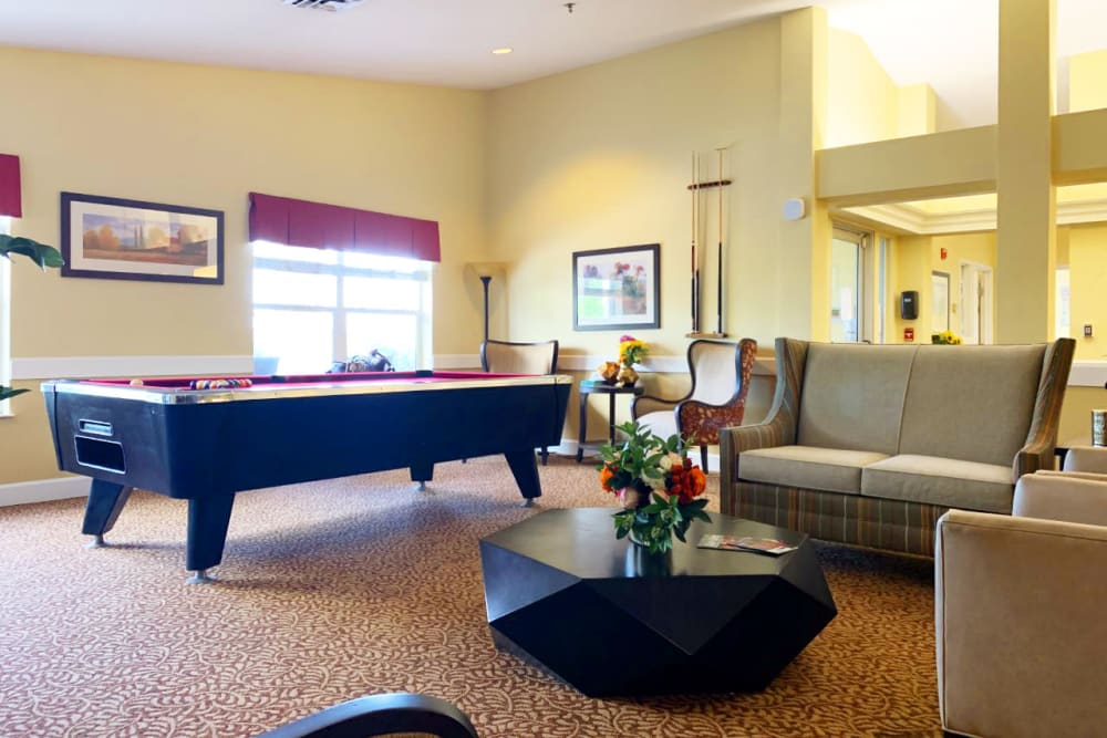 A cozy living room with a pool table at Lassen House Senior Living in Red Bluff, California