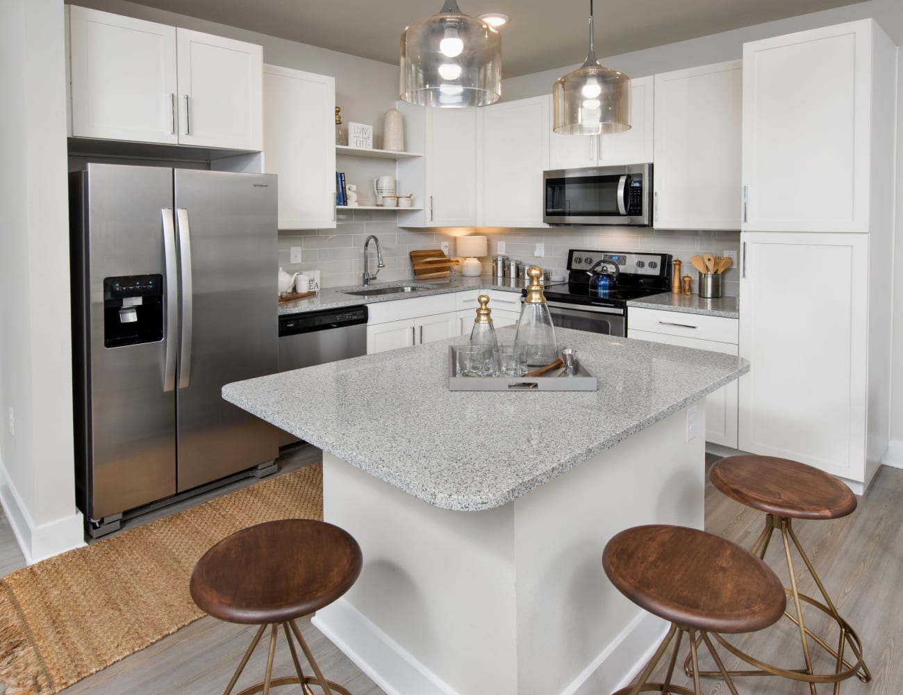 Open-concept layout with hardwood floors and stainless-steel appliances at The Elysian in St Johns, Florida