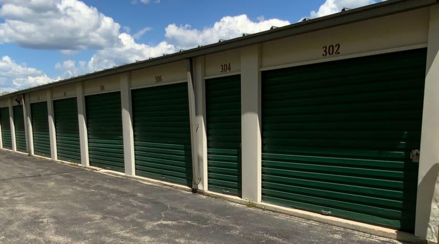 Storage units with blue doors and locks at KO Storage of Windham in Windham, Maine