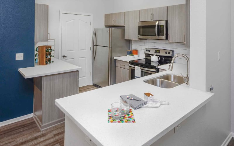White cabinets in a kitchen at The Grove at Orenco Station in Hillsboro, Oregon
