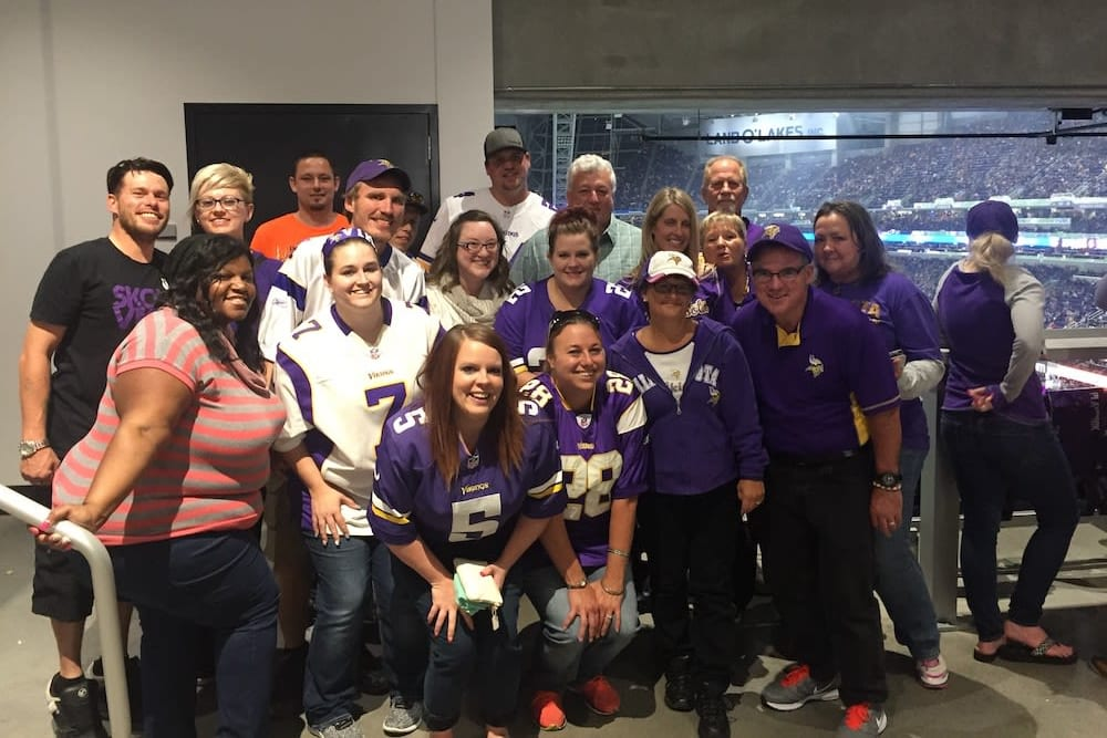 CAPREIT team members posing for photo at Vikings game