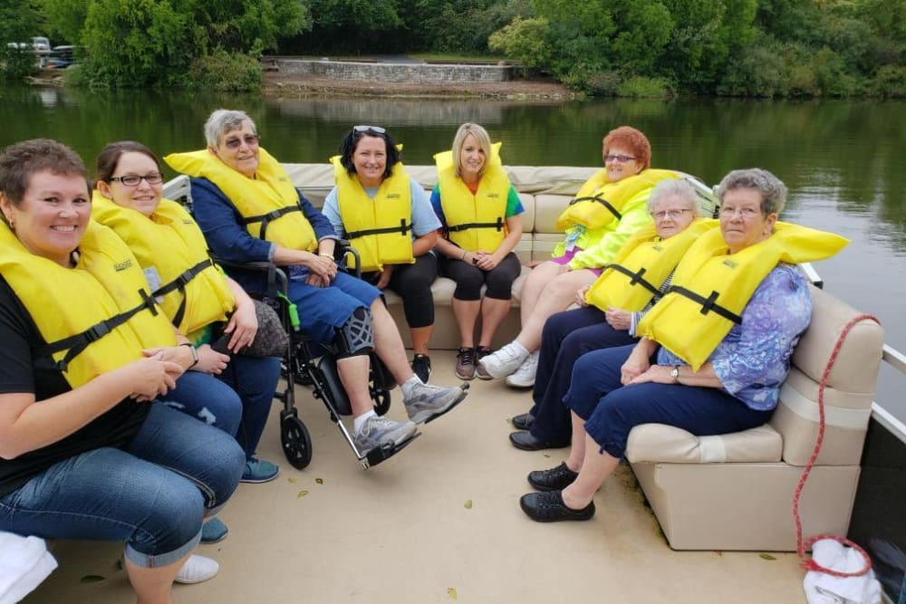 Residents at Village Green Health Campus enjoy a group outing at the lake on a boat in Greenville, Ohio