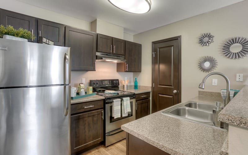 Kitchen with stainless steel appliances at Pebble Cove Apartments in Renton, Washington
