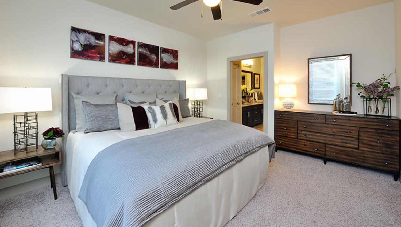 Model bedroom at Olympus Falcon Landing in Katy, Texas