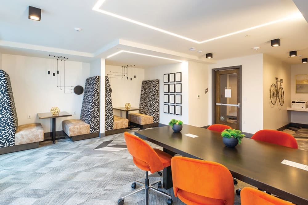 Meeting areas with semi-private booth seating in the co-working space at ArLo Apartments in Portland, Oregon