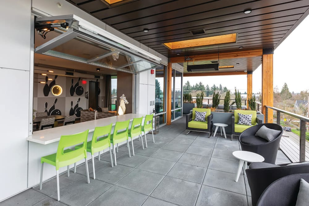 Lounge areas outside the rooftop resident lounge at ArLo Apartments in Portland, Oregon
