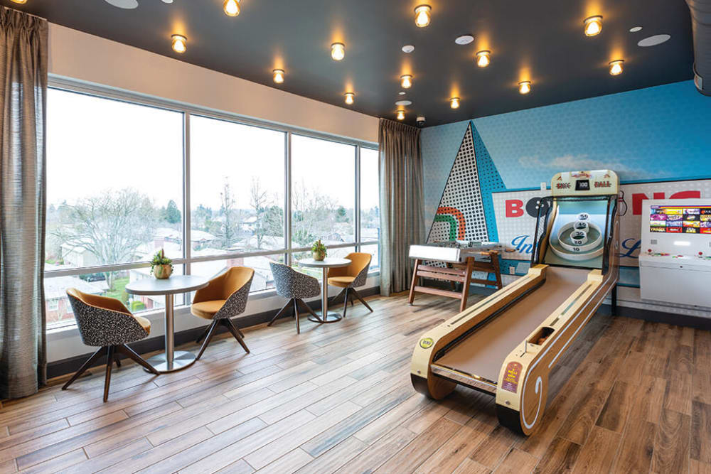Skee-ball and more games to choose from in the arcade lounge at ArLo Apartments in Portland, Oregon