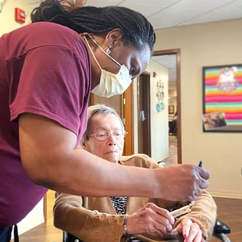 A team member and resident at The Oxford Grand Assisted Living & Memory Care in Kansas City, Missouri