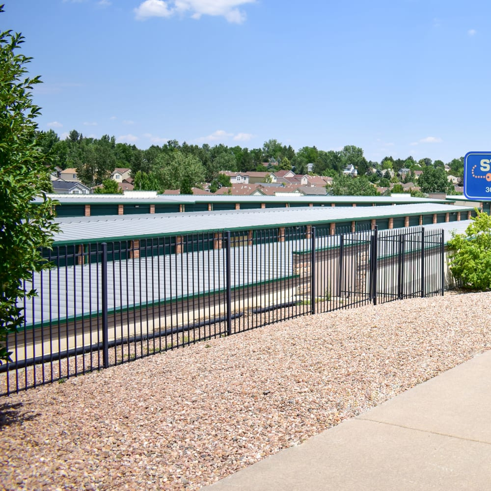 The secure front gate at STOR-N-LOCK Self Storage in Littleton, Colorado