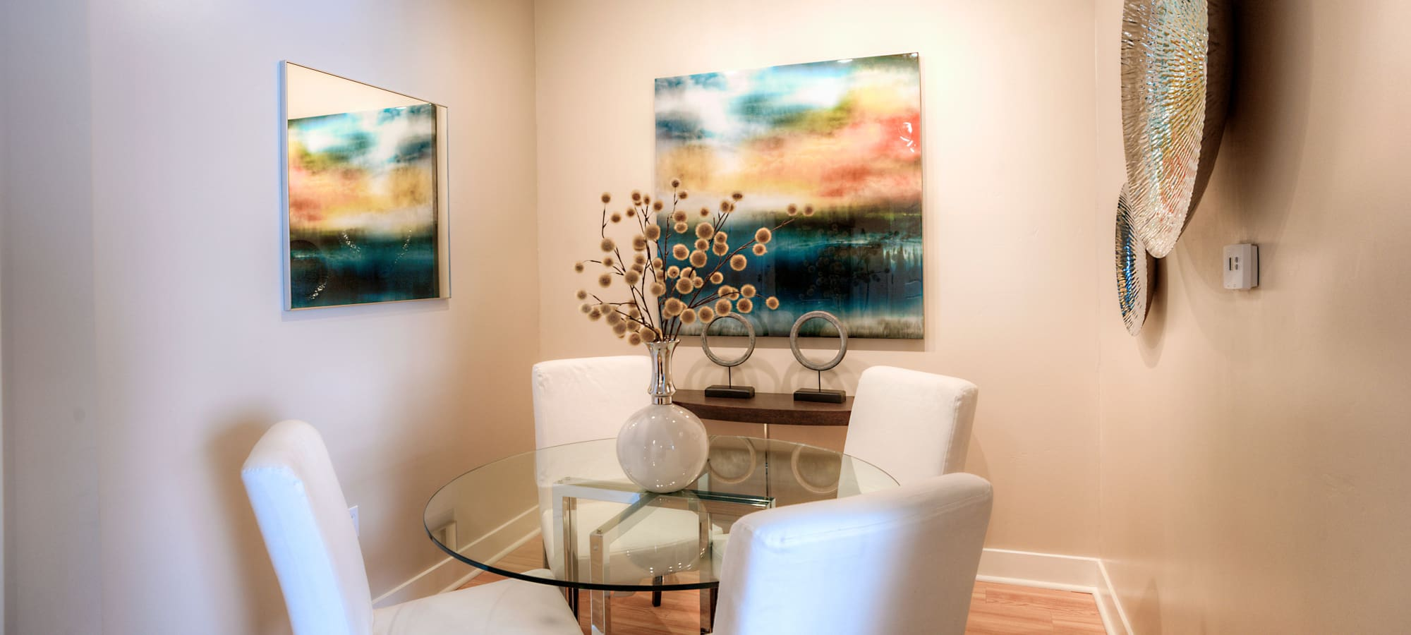 Dining nook with modern art in model home at Level at Sixteenth in Phoenix, Arizona