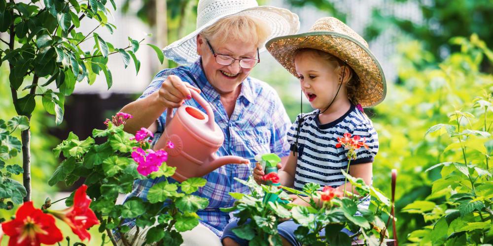 Grandmother and grandson gardening at The Springs at Lancaster Village in Salem, Oregon