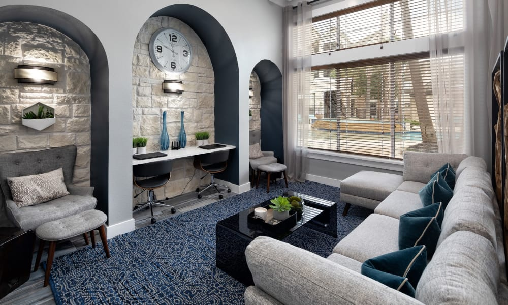 View of the resident clubhouse lounge area from the lobby entrance at The Retreat at Cinco Ranch in Katy, Texas