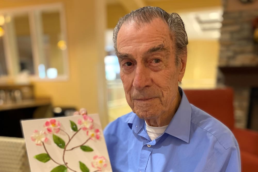 senior resident holding a piece of art at The Pines, A Merrill Gardens Community in Rocklin, California