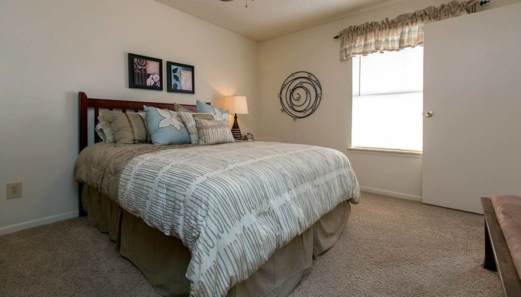 Primary bedroom at Walnut Ridge Apartments in Corpus Christi, Texas