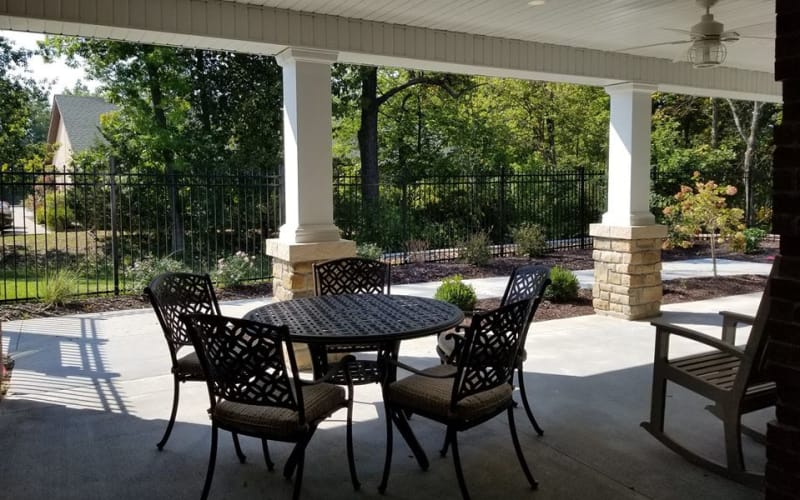 Outdoor patio with chairs at The Arbors at Harmony Gardens in Warrensburg, Missouri