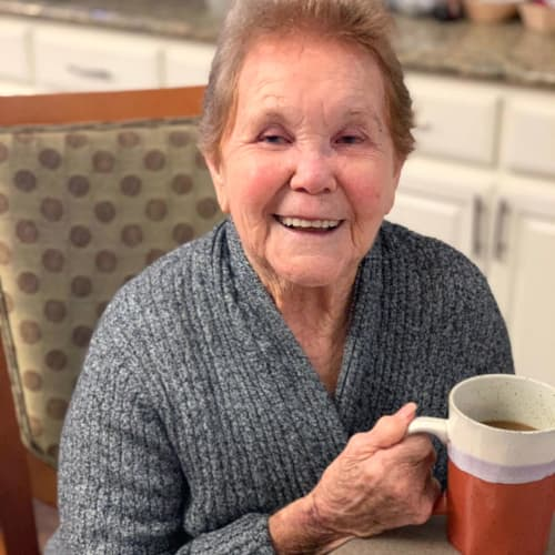 Resident with a cup of coffee at FountainBrook in Midwest City, Oklahoma