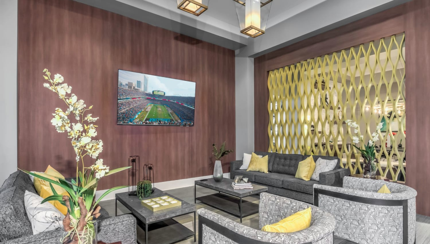 Comfortable clubhouse lounge with a flat-screen TV at The Palmer in Charlotte, North Carolina