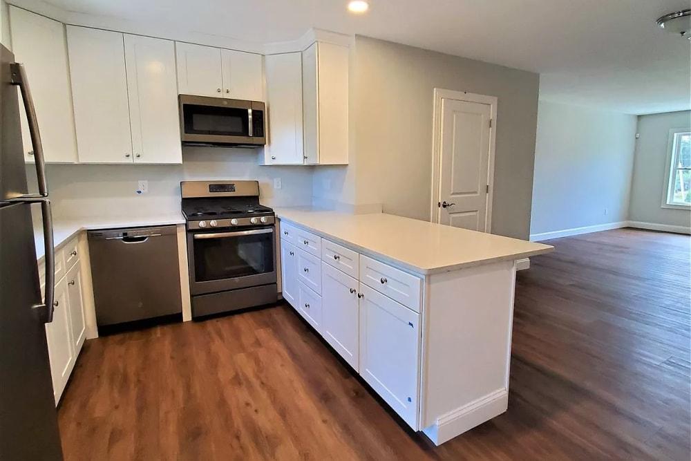 Bedroom with hardwood flooring at Eagle Rock Apartments at Nashua in Nashua, New Hampshire
