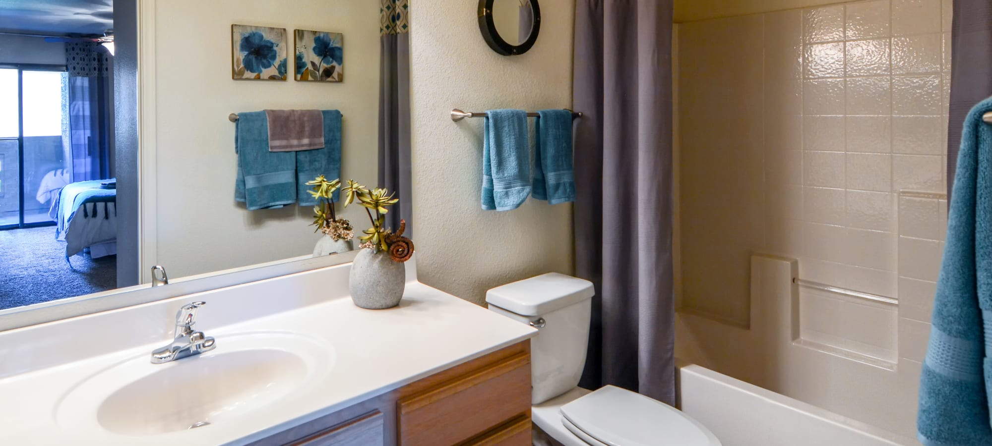 Bathroom with blue accents at The Palms on Scottsdale in Tempe, Arizona