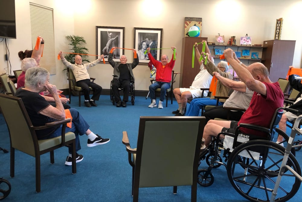Residents in a wellness class at CERTUS Premier Memory Care Living in Orlando, Florida.