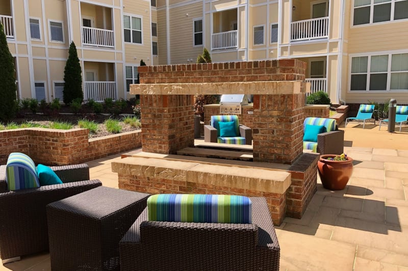 Outdoor lounge chairs by fire at Level at 401 in Raleigh, North Carolina