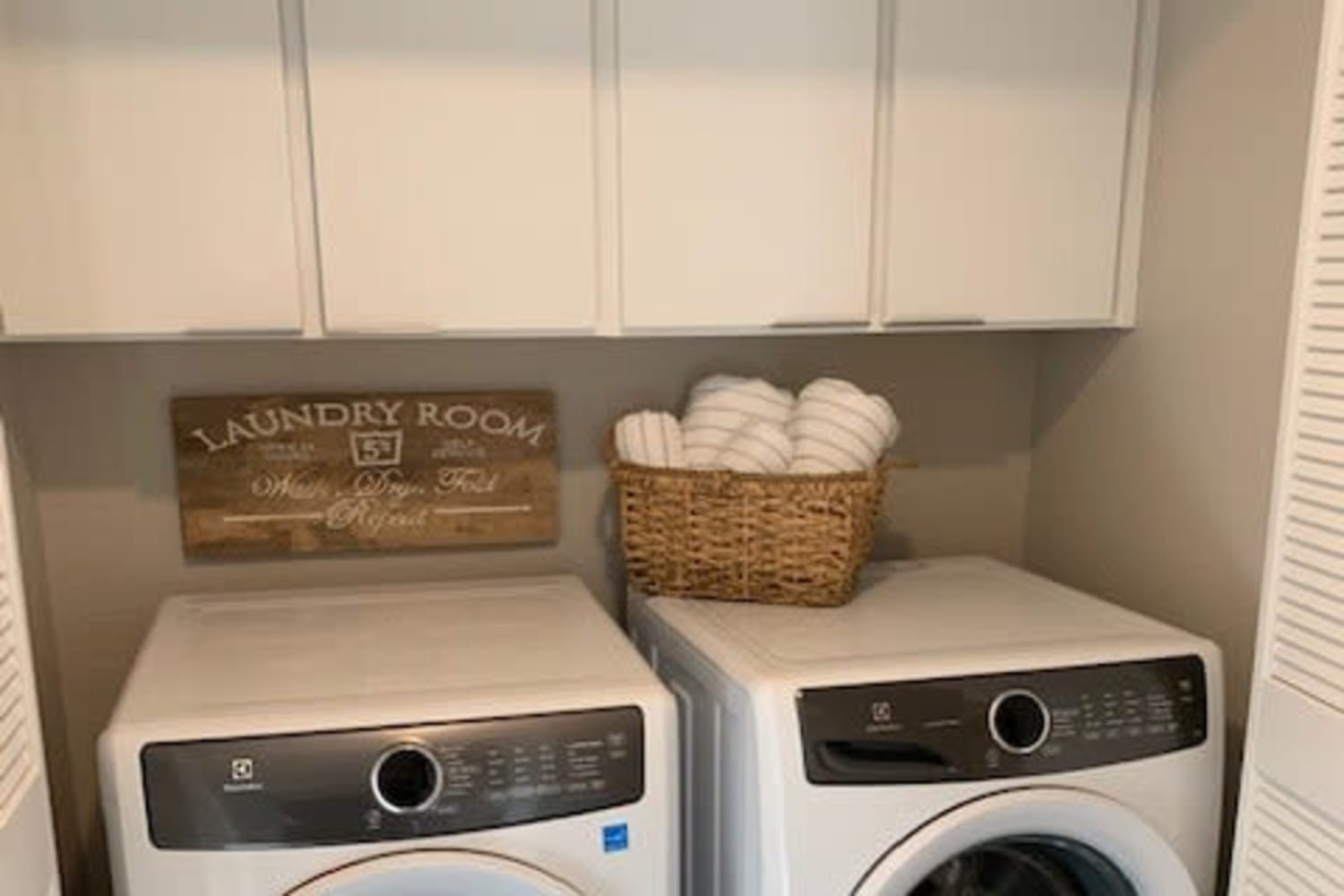 Washer and dryer area at Cotton Wood Apartments in Dublin, California
