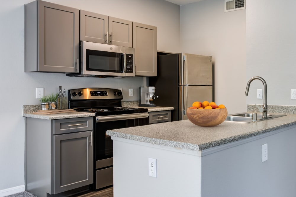 A newly renovated grey cabinetry kitchen with plenty of cabinet space at Miramonte and Trovas in Sacramento, California