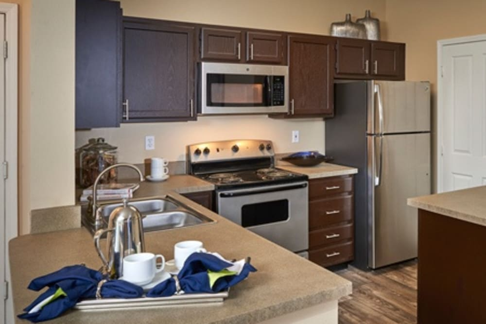 Kitchen with plenty of cabinet space at Legend Oaks Apartments in Aurora, Colorado