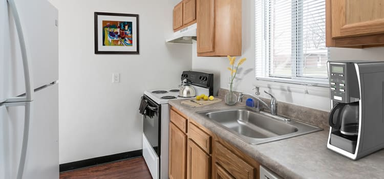 Well-equipped kitchen at Brockport Crossings Apartments & Townhomes home