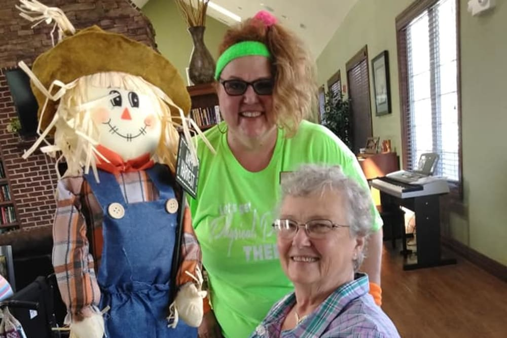 A resident and a scarecrow at Villas of Holly Brook Herrin in Carterville, Illinois