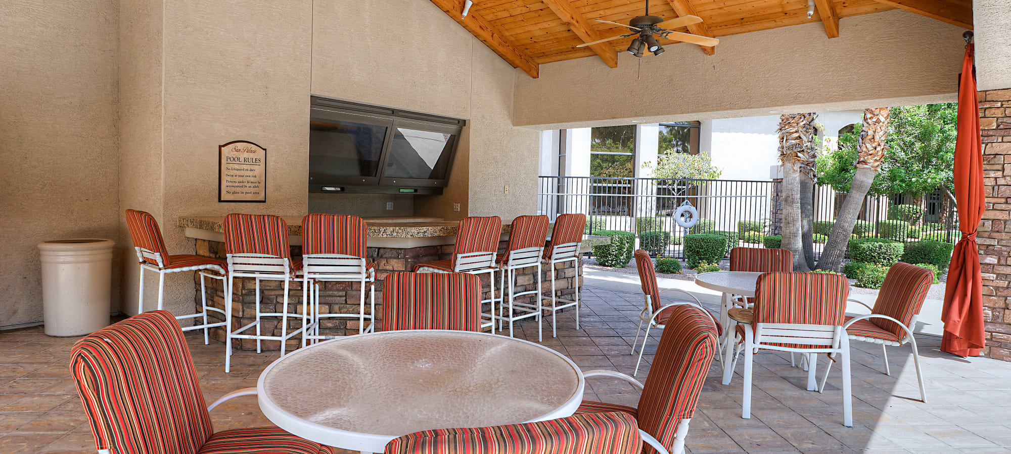 Comfortable seating and cabanas near the pool at San Palacio in Chandler, Arizona