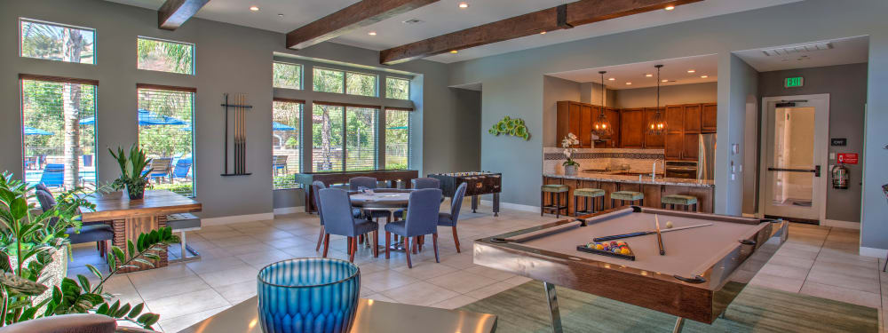 Billiards and plentiful seating in the resident lounge at Palisades Sierra Del Oro in Corona, California