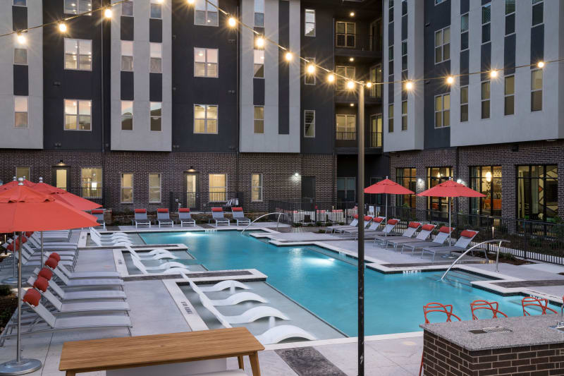 Large pool and fire pit at The ReVe in Garland, Texas