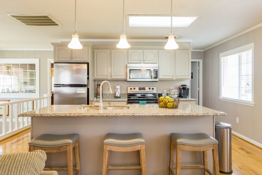 Kitchen with bar stools at Salem Wood Apartments in Salem, Virginia