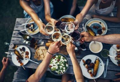 Friends enjoying drinks with their dinner near 1303 Main in Duncanville, Texas