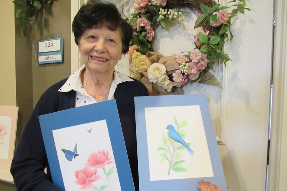 Resident with paintings at Aspired Living of Westmont