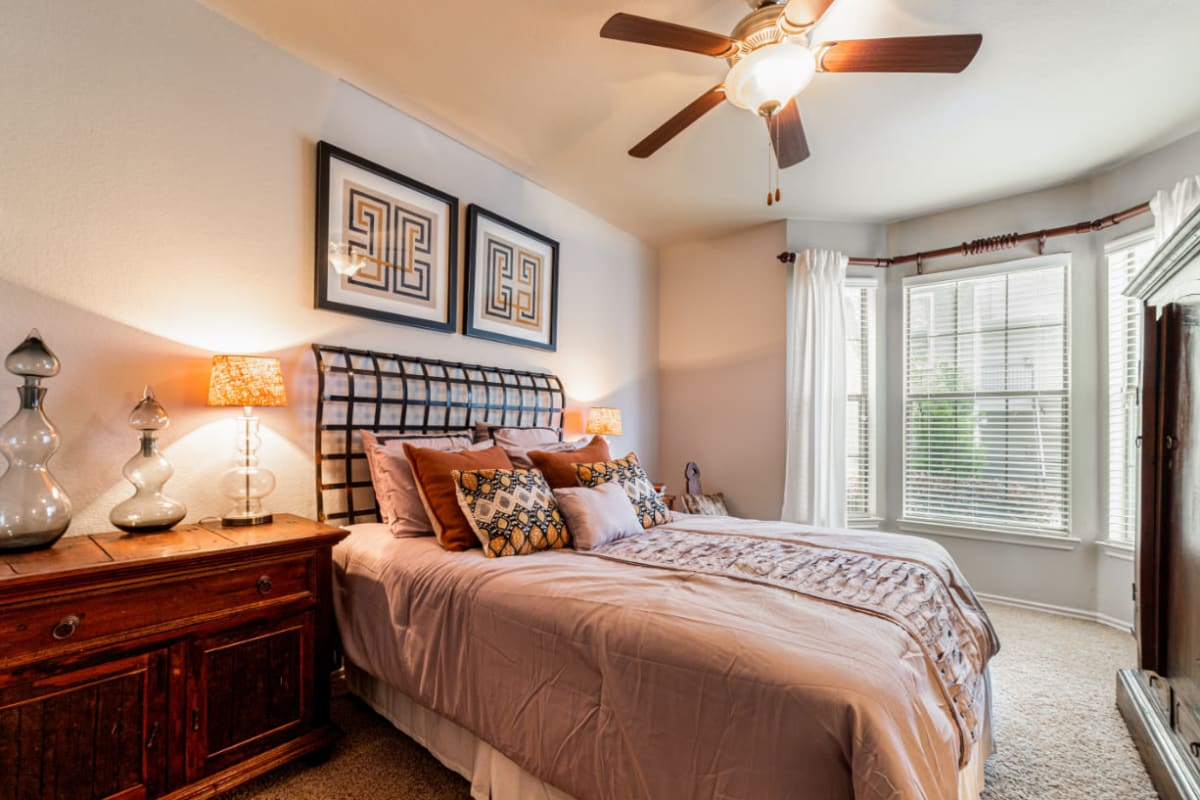 Well-lit spacious bedroom at Marquis at Lantana in Flower Mound, Texas