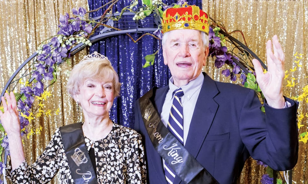 Prom king and queen posing for a photo at Liberty Heights Gracious Retirement Living in Rockwall, Texas