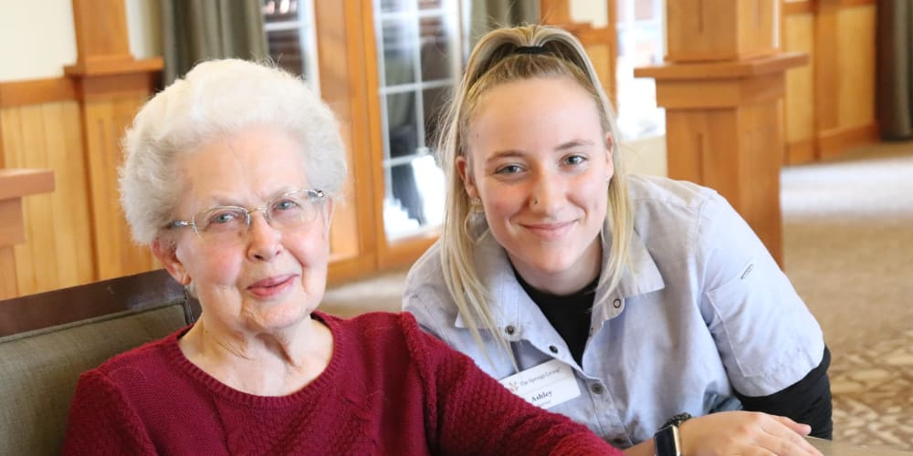Resident enjoying coffee with caregiver at The Springs at Missoula in Missoula, Montana
