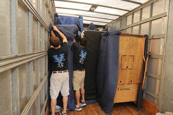Virginia Varsity Transfer staff expertly load a moving truck in Salem, Virginia